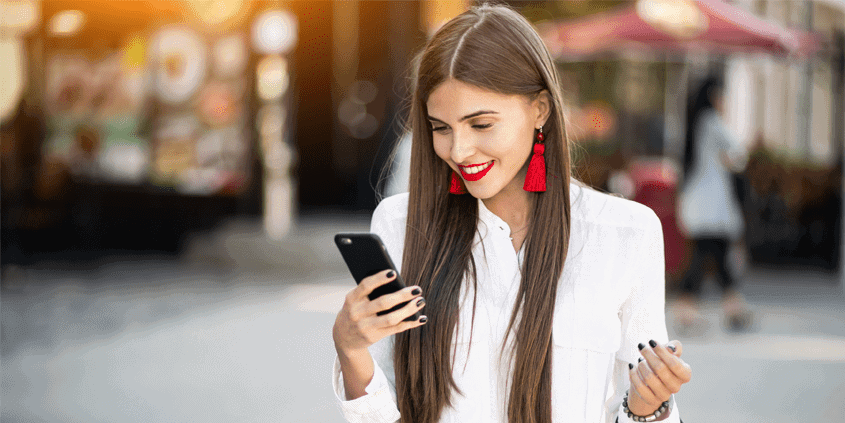 Mobile-First-Index---header---girl-using-phone
